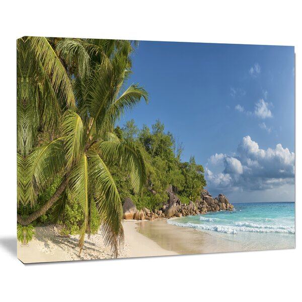Dark Blue Anse Georgette Beach Photographic Print on Wrapped Canvas by Design Art