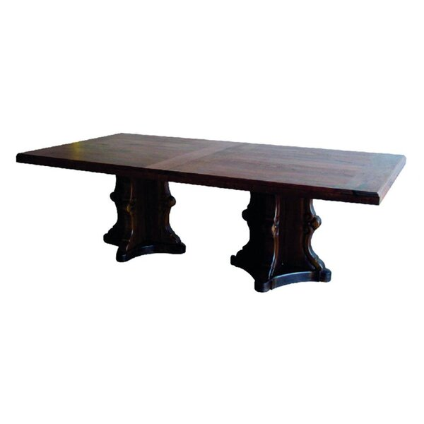 Huges Southwestern Solid Wood Dining Table by Fleur De Lis Living