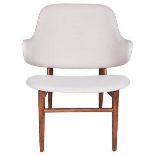 Cameo Curve Wingback Chair. By Joseph Allen