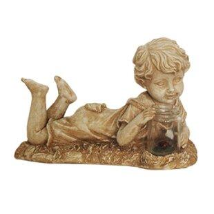 Lovely Lounging Boy Garden Statue