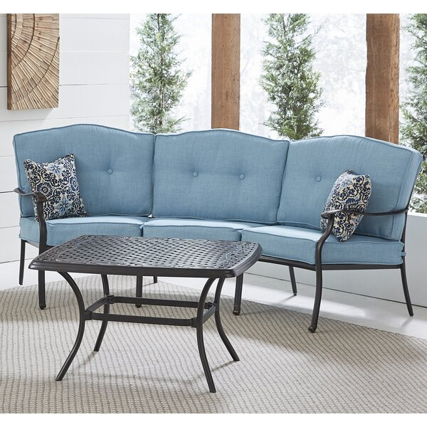 Carleton 2-Piece Patio Set with Cast-Top Coffee Table and Crescent Sofa in Blue by Fleur De Lis Living