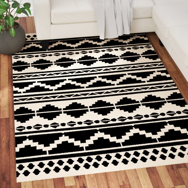 Carrizales Hand-Woven Wool Black/Grey Ikat Area Rug by Mercury Row