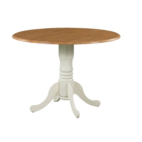 Shows Drop Leaf Solid Wood Dining Table by August Grove
