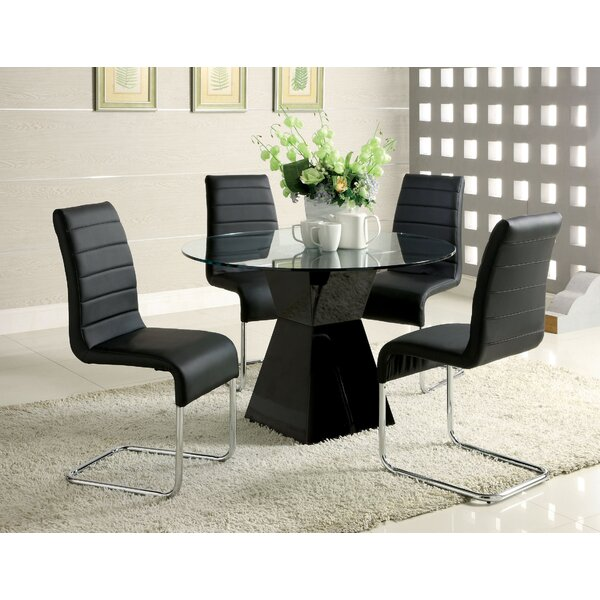 Chiron Dining Table by Orren Ellis