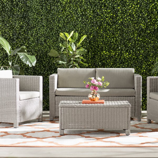 Furst 4 Piece Rattan Sofa Seating Group with Cushions by Wade Logan