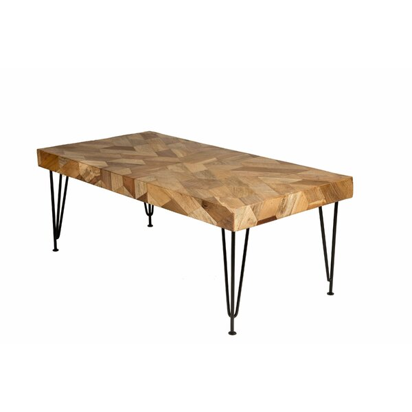 Manatuto Impression Coffee Table by Union Rustic