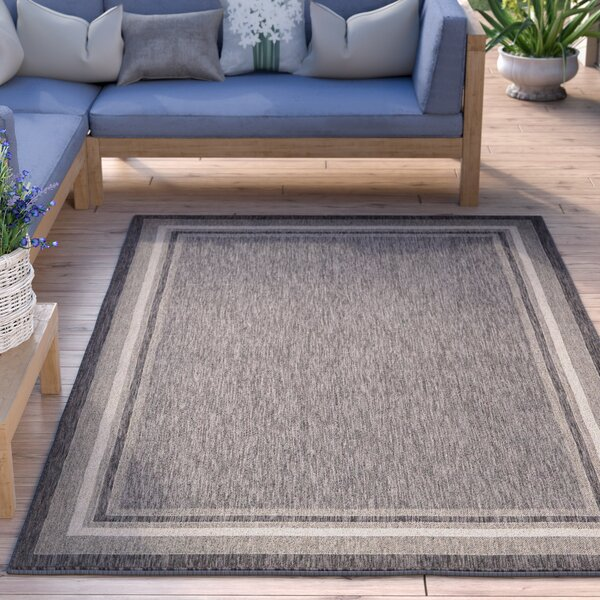 Tapley Black Outdoor Area Rug by August Grove