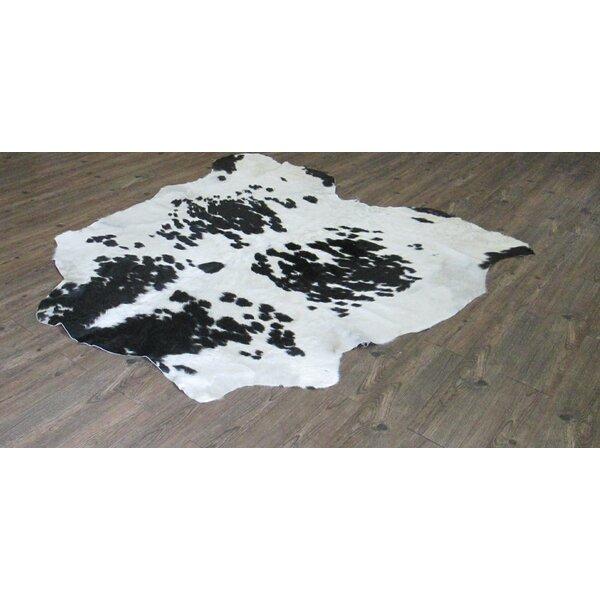 Varian Hand-Woven Cowhide Off-White/Black Area Rug by Loon Peak