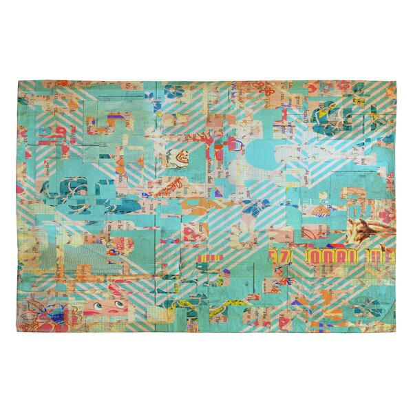 MIK 42 Blue Area Rug by Deny Designs