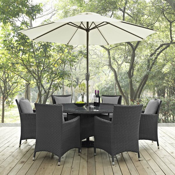 Tripp 8 Piece Dining Set with Sunbrella Cushions and Umbrella by Brayden Studio
