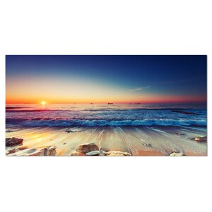'Beautiful Sunrise Over Blue Sea' Photographic Print on Wrapped Canvas by Design Art