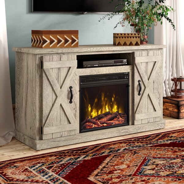 Inexpensive Lorraine TV Stand for TVs up to 55 with Electric Fireplace Included by Laurel Foundry Modern Farmhouse