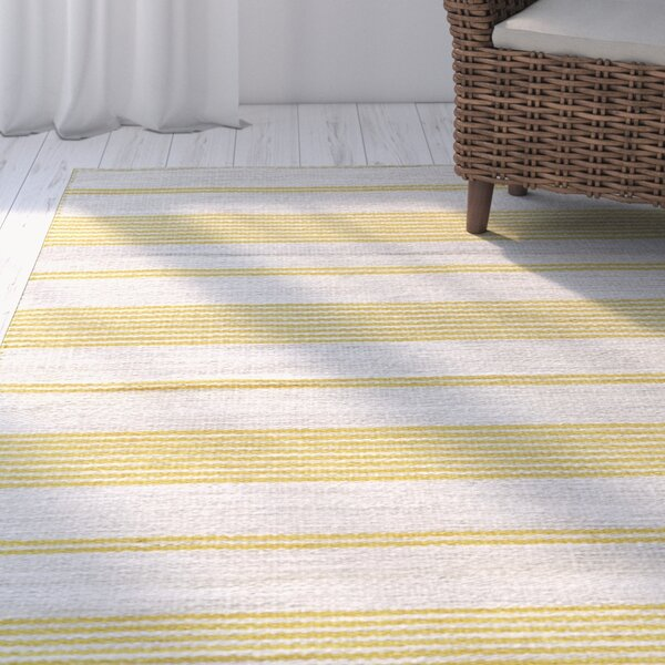 Alicea Hand-Woven Gold Area Rug by Three Posts