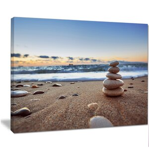 'Stones Balance on Sandy Beach' Photographic Print on Wrapped Canvas by Design Art