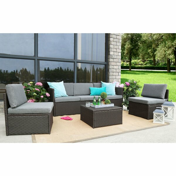 Heger 4 Piece Rattan Sectional Seating Group with Cushions by Ebern Designs