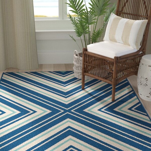 Martinique Navy Area Rug by Breakwater Bay