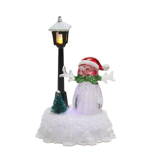 led lighted changing snowman with santa hat and lamp post christmas decoration