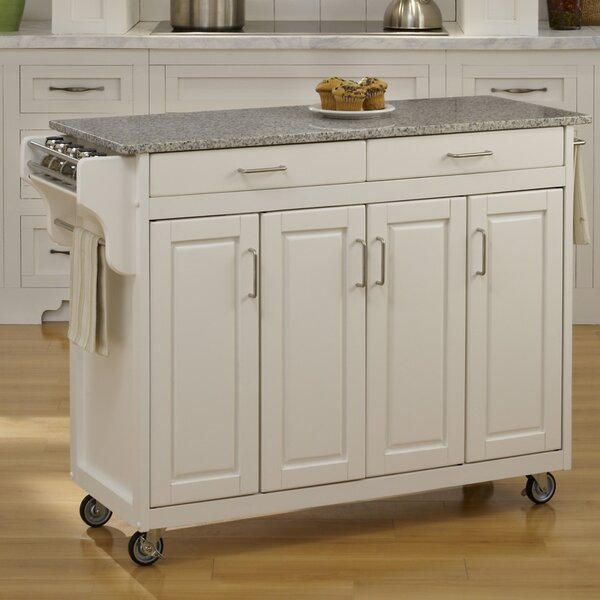 Regiene Kitchen Island with Granite Top by August Grove