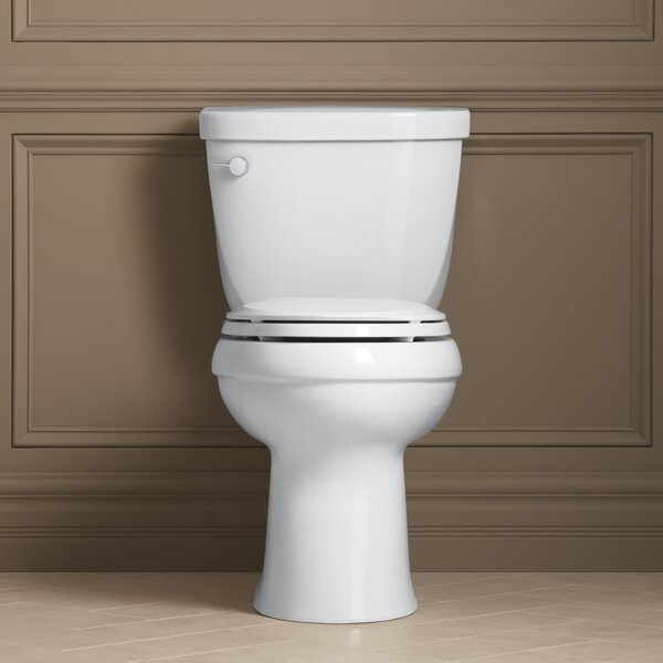 Cimarron Comfort Height Two-Piece Elongated 1.28 GPF Toilet with Aquapiston Flush Technology and Left-Hand Trip Lever by Kohler