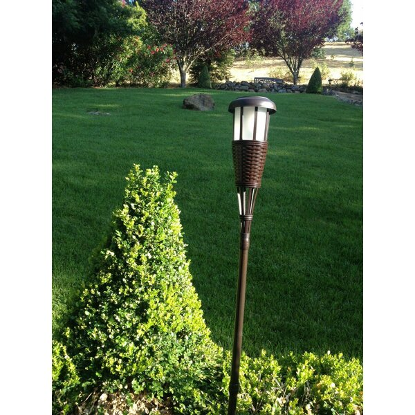 Solar Powered Tiki Torch Set By Newhouse Lighting.