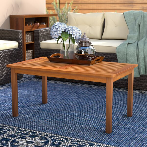 Cadsden Solid Wood Coffee Table by Three Posts