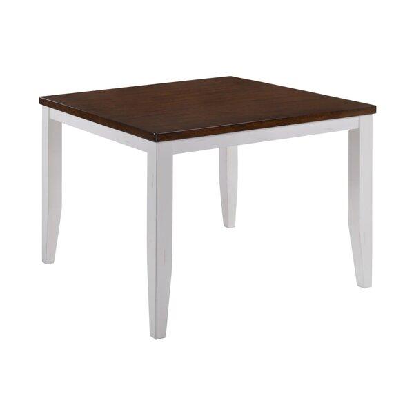 Adalard Solid Wood Dining Table by August Grove