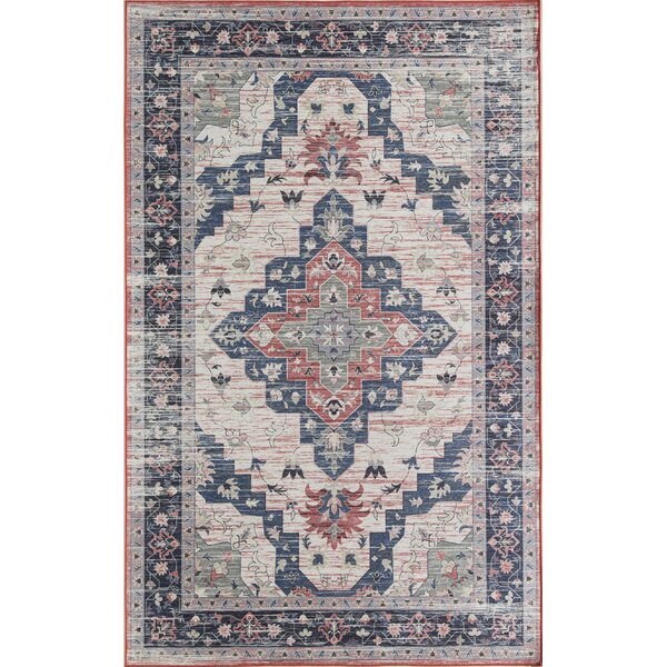 Sasha Ivory/Dark Blue Area Rug by CosmoLiving by Cosmopolitan