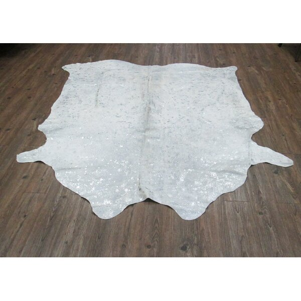Roberto Hand Woven Cowhide Metallic White Area Rug by Orren Ellis