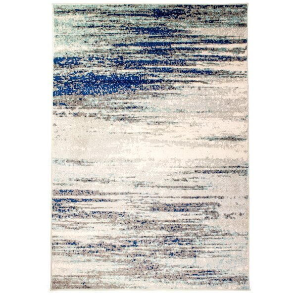 Benoit Distressed Ivory/Blue Area Rug by Bungalow Rose