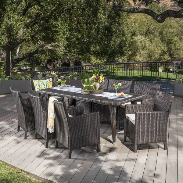 Luebke 9 Piece Dining Set with Cushions by Orren Ellis