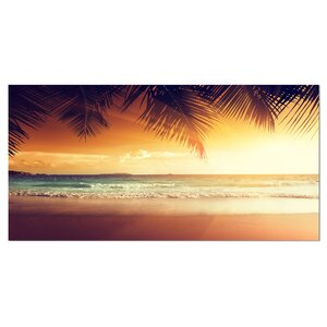 Palm Leaves on Caribbean Seashore Photographic Print on Wrapped Canvas by Design Art