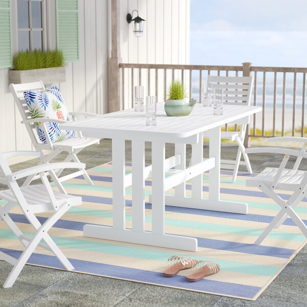 Araline Solid Wood Dining Table by Beachcrest Home