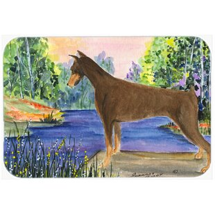 Doberman and Forest Glass Cutting Board By East Urban Home