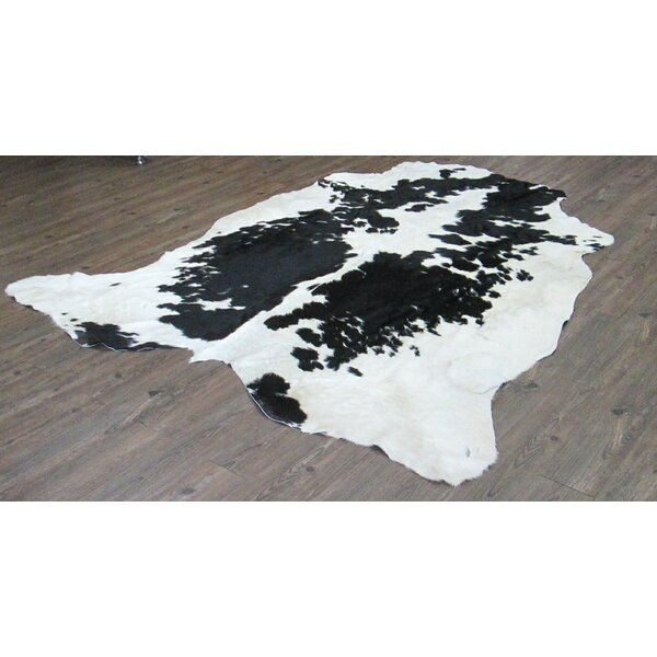Wakefield Hand-Woven Cowhide Black/White Area Rug by Loon Peak