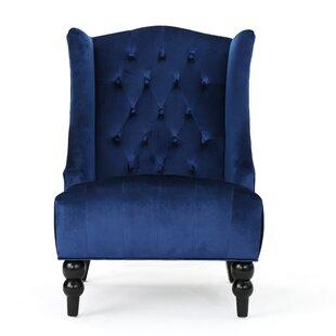 Look for Potterslane High-Back New Velvet Wingback Chair by Alcott Hill