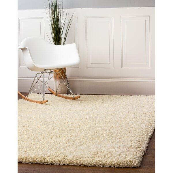 Aurea Vanilla Cream Area Rug by Ebern Designs