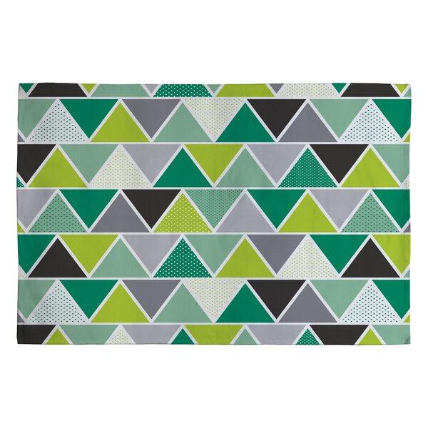 Heather Dutton Emerald Triangulum Green Geometric Area Rug by Deny Designs