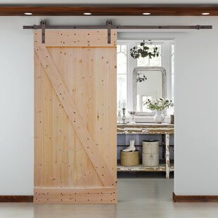 32x84 interior door wayfair solid wood panelled knotty pine slab interior barn door planetlyrics Image collections