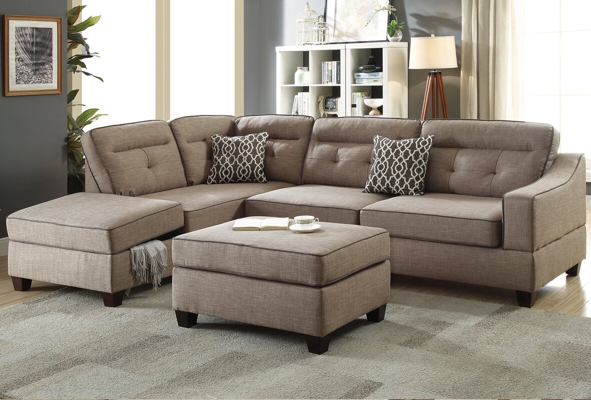 Sarah Reversible Sectional With Storage Compartment And Ottoman
