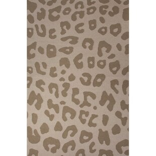 https://secure.img1-ag.wfcdn.com/im/29402834/resize-h310-w310%5Ecompr-r85/3685/36853840/national-geographic-home-collection-wool-tan-leopard-flat-weave-area-rug.jpg