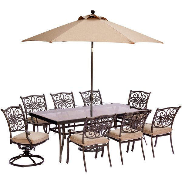 Carleton 9 Piece Glass Top Dining Set with Cushions and Umbrella by Fleur De Lis Living