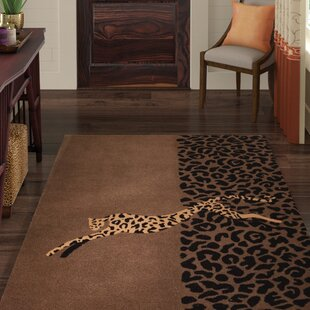Riveria Wool Brown/Black Area Rug by World Menagerie