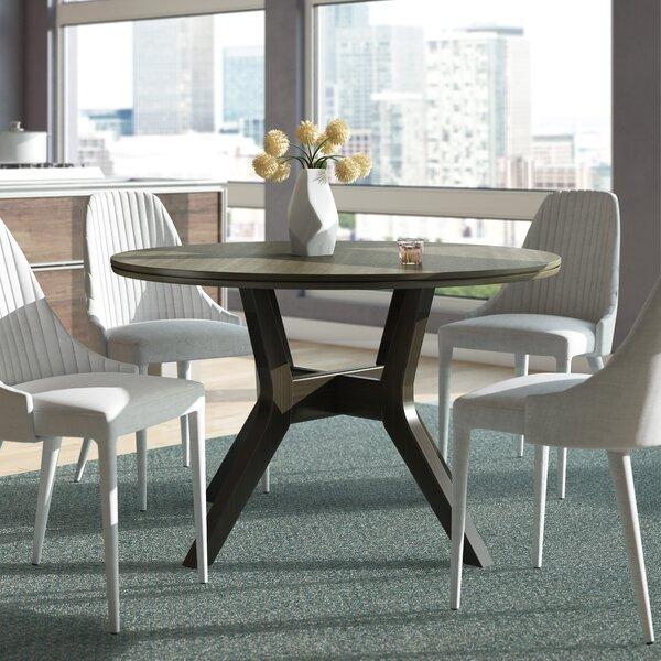 Stiltner Mid-Century Modern Dining Table by Wrought Studio