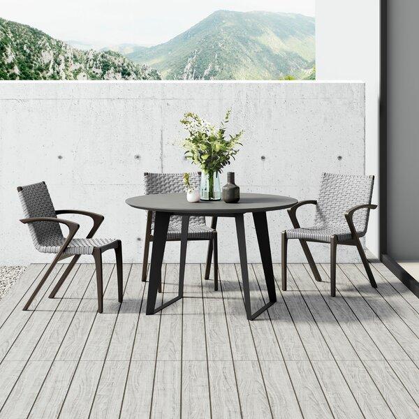 Salaam Stone/Concrete Dining Table by Orren Ellis