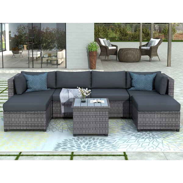 Aloisa 7 Piece Rattan Sectional Seating Group with Cushions