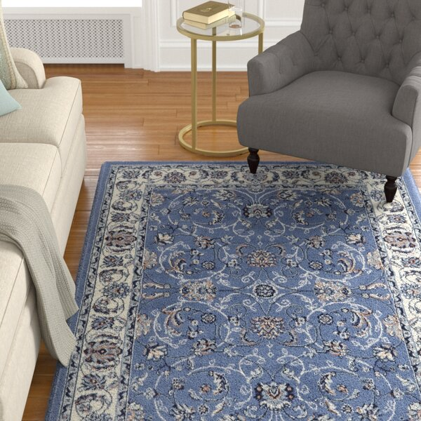Lilly Traditional Border Blue/Ivory Area Rug by Astoria Grand