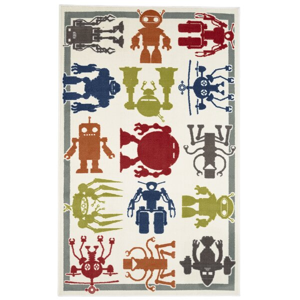 Alanna Synthetic Cream Area Rug by Zoomie Kids
