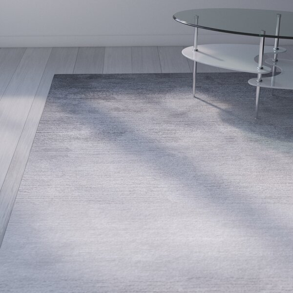 Deskins Hand-Tufted Gray Area Rug by Wade Logan
