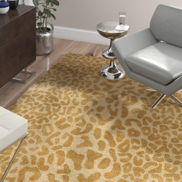 Macias Beige Animal Print Area Rug by Wade Logan