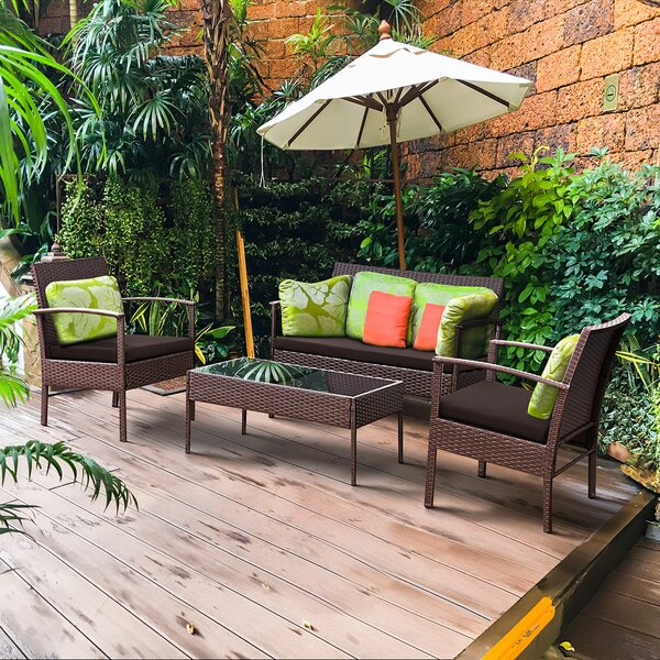 Valerian 4 Piece Rattan Sofa Seating Group with Cushions by Wrought Studio